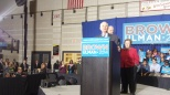 Senator Barbara Mikulski in the background as Sen. Cardin speaks