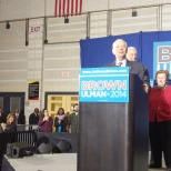 Senator Barbara Mikulski in the background as Sen. Cardin speaks