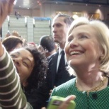 Clinton takes selfies with students in the crowd