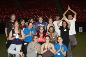 Group of students in pose after the Yoga World Record event, Tuesday, Oct. 14, 2014, in Cole Field House.