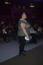 One of the hosts for the show watches her sorority, Delta Sigma Theta, perform on stage