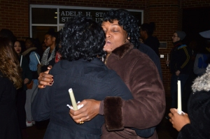 Fennell and Sharp hug after the vigil.