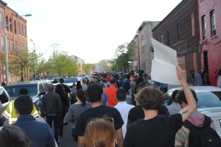 Protestors march in Penn North Station. Tuesday, April 28, 2015