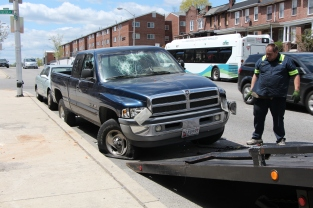 """Tow trucker removes damaged vehicle from streets. When asked how his day was going, he shook his head and said """"I've been doing this all day."""" April 28, 2015"""