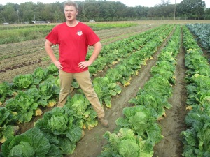 Tristan Madden/ Pulsefeedz Terp Volunteer Michael Perise shows off the cabbage he has been growing for the past few weeks.